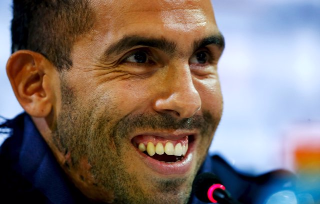Argentina's Carlos Tevez smiles during his presentation as Boca Juniors' new pla