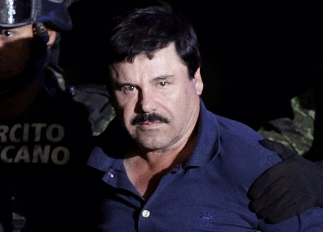 "Recaptured drug lord Joaquin ""El Chapo"" Guzman is escorted by soldiers at the ha"