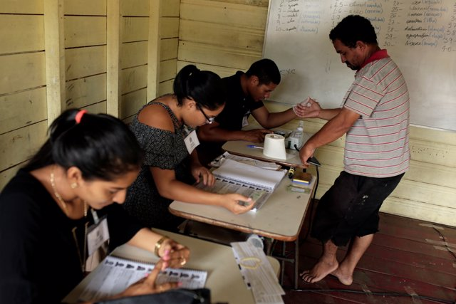 Brazilians vote in a runoff election in Catalao, a community of houseboats, in A