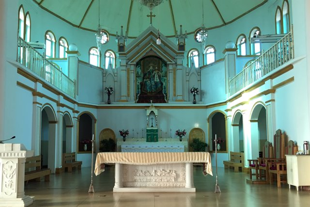 The altar and a painting of the Virgin Mary, known locally as Our Lady of China,