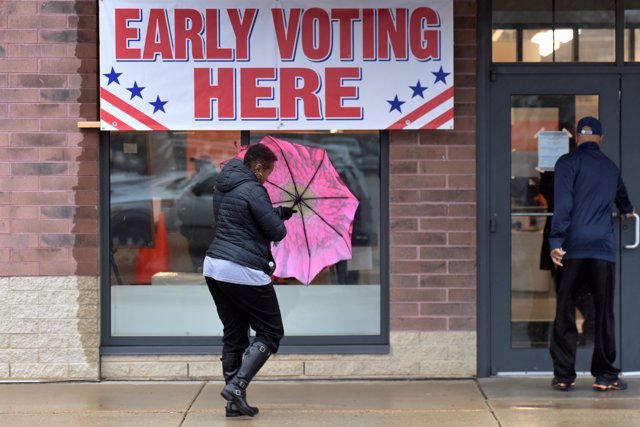 Voters enter an early voting polling station in Milwaukee, Wisconsin, U.S. Novem