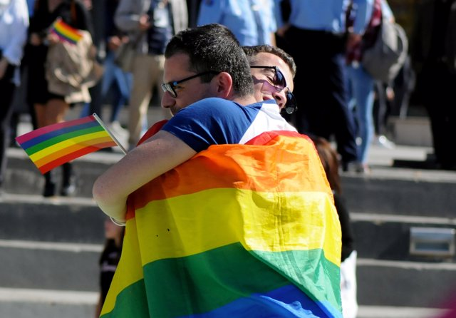 People hug during the second lesbian, gay, bisexual and transgender (LGBT) Pride
