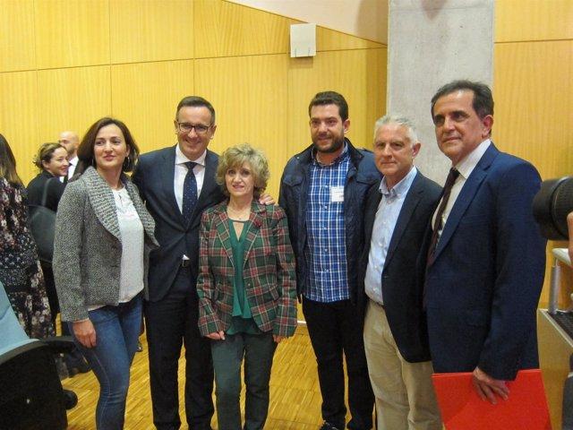 La ministra, con Conesa y Serrano, durante la Conferencia