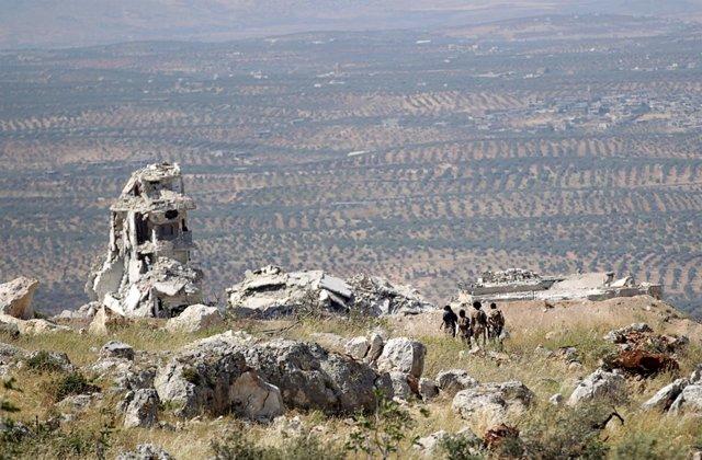Combatientes rebeldes en Idlib