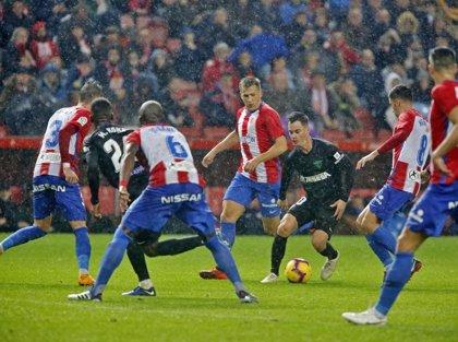 El Sporting evita el liderato del Málaga y el Granada se mantiene sin goles