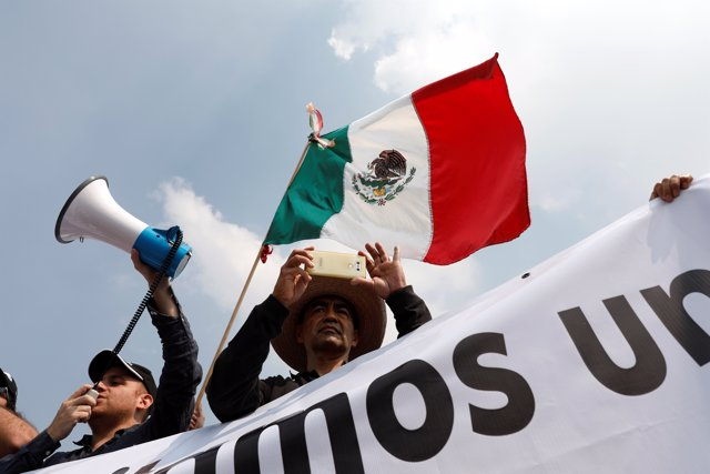 People take part in a march in opposition to President-elect Andres Manuel Lopez