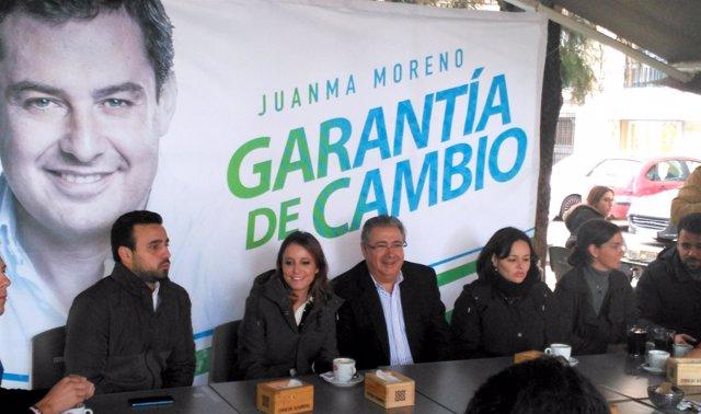 Andrea Levy, Juan Ignacio Zoido y Virginia Pérez, en un acto con NNGG