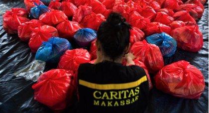 Cáritas Española aporta 200.000 euros a los damnificados del tsunami en Indonesia y del tifón en Filipinas