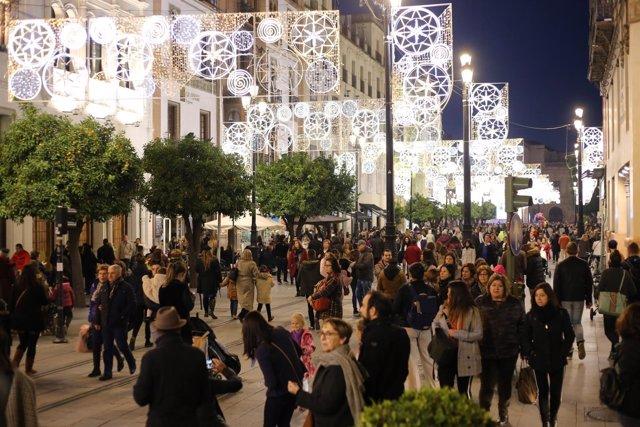 Gente, iluminación navideña, población