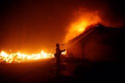 Més de 600 desapareguts i 63 morts a causa dels incendis a Califòrnia (REUTERS / ERIC THAYER)