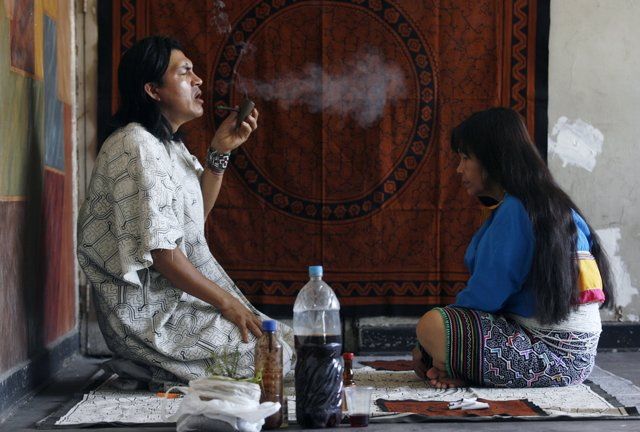 Pedro Tangoa, a shaman, performs a ritual treatment for the photographer after d
