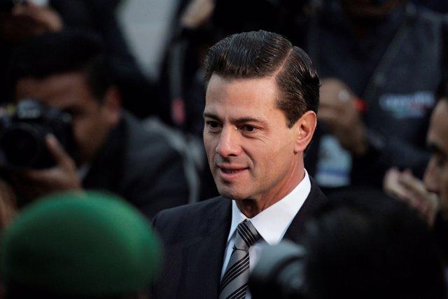 Mexican President Enrique Pena Nieto attends a flag-raising ceremony honouring t