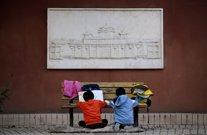 Niños estudian en Pekín, China