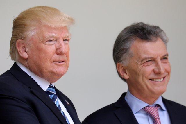 U.S. President Donald Trump talks with Argentina's President Mauricio Macri duri