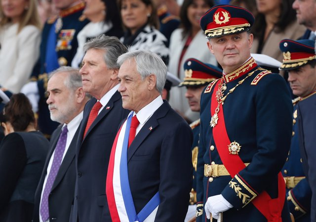 Chile's Commander in Chief of the Army, General Ricardo Martinez is seen next to