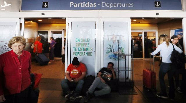 Passangers wait at Buenos Aires' airport as flights were cancelled during a stri