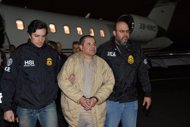 "FILE PHOTO: Mexico's top drug lord Joaquin ""El Chapo"" Guzman is escorted as he a"
