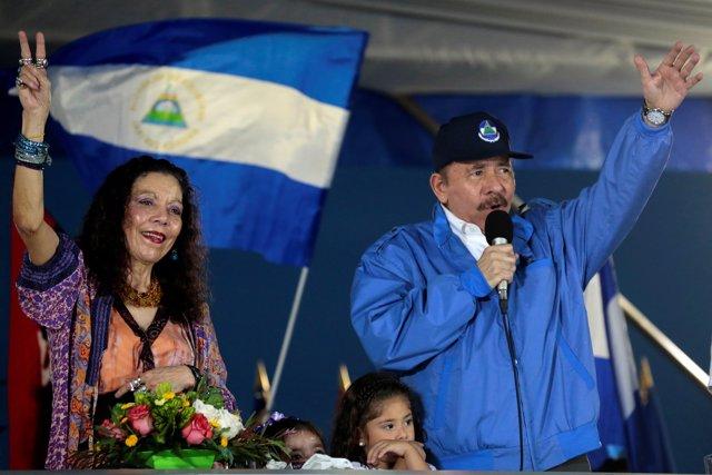 Nicaraguan President Daniel Ortega and Vice-President Rosario Murillo greet supp