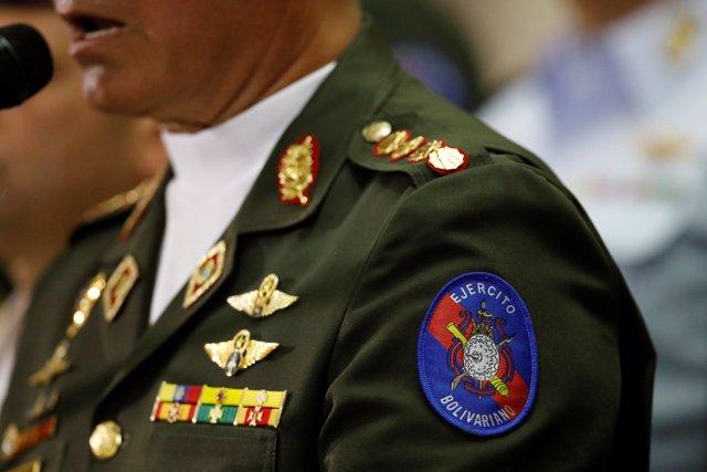 A detail of the Venezuelan army badge is seen on the uniform of Venezuela's Defe