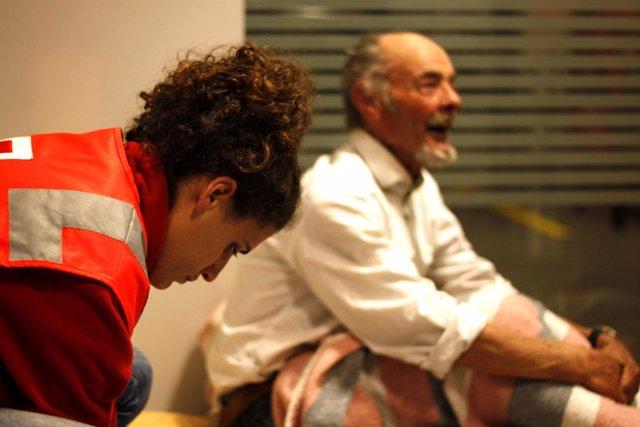 Cruz Roja con personas sin hogar