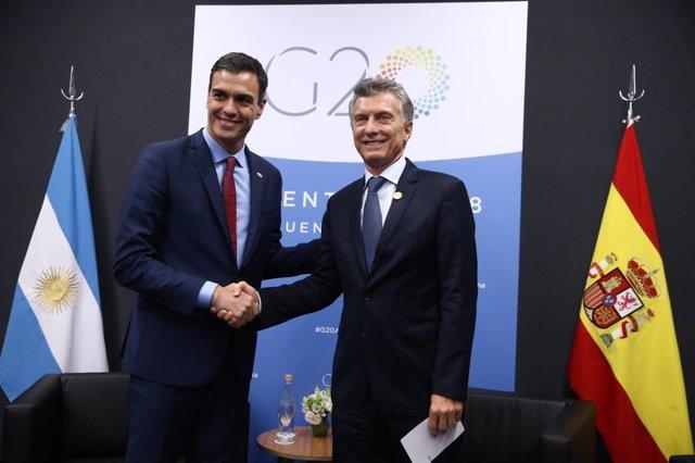 Pedro Sánchez y Mauricio Macri