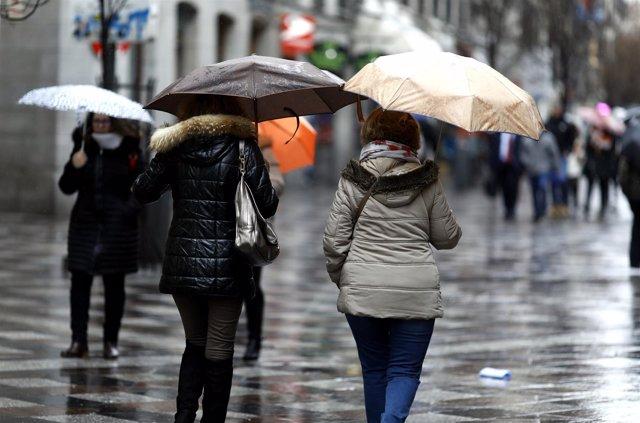 Personas con paraguas un día de lluvia