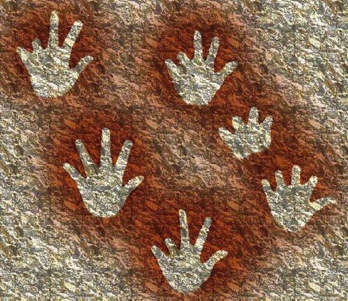 Réplica de las manos en negativo pintadas en las paredes de la cueva de Gargas