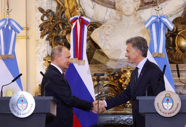 Russia's President Vladimir Putin shakes hands with Argentina's President Mauric