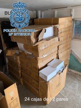 Cajas de zapatillas deportivas falsificadas intervenidas por la Policía