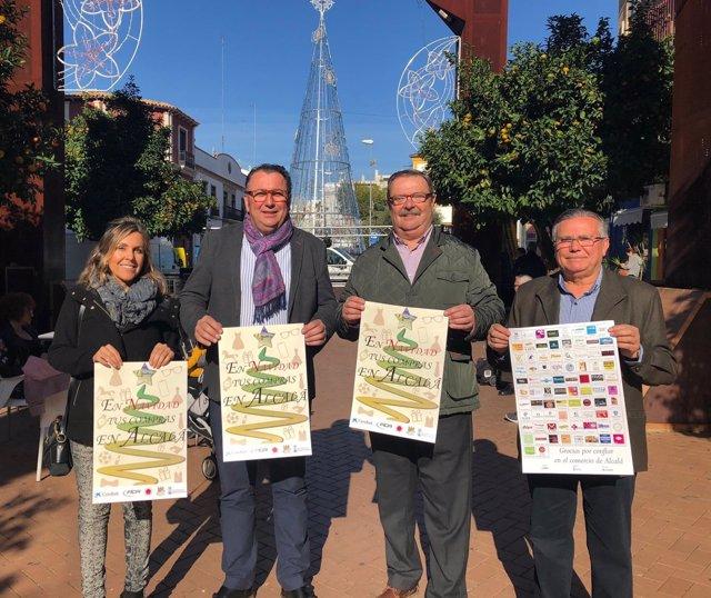 Presentación del cartel de la campaña de Navidad en el comercio de Alcalá