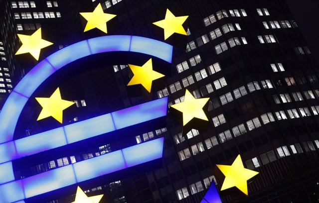 An illuminated euro sign is seen in front of the headquarters of the European Ce