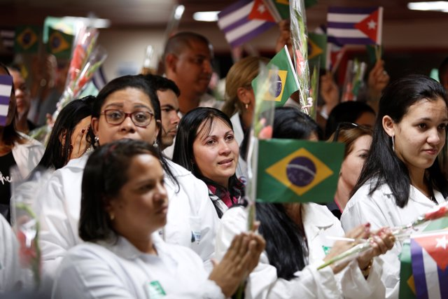 Cuban doctors take part in a welcoming ceremony at the Jose Marti International