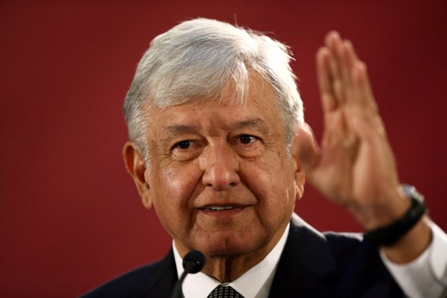 FILE PHOTO: Mexico's new President Andres Manuel Lopez Obrador speaks as he hold