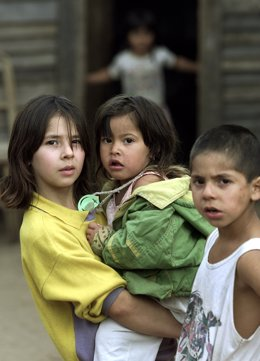 Maria Elena Almiron Quiroga (L) holds her sister Noelia as her brother Johnatan