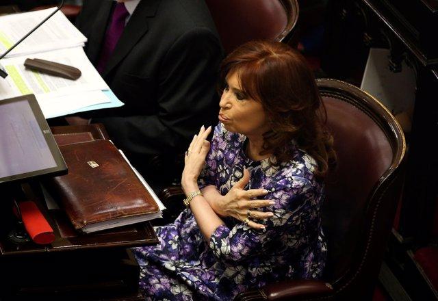 Former Argentine President and senator Cristina Fernandez de Kirchner gestures d