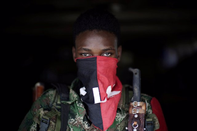 A rebel from Colombia's Marxist National Liberation Army (ELN) poses for a photo