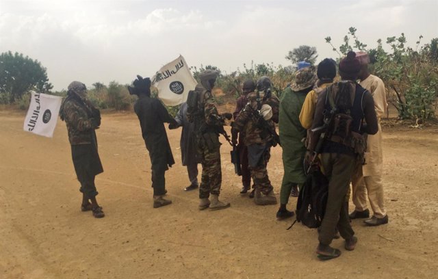 Boko Haram militants (in camouflage) embrace and shake hands