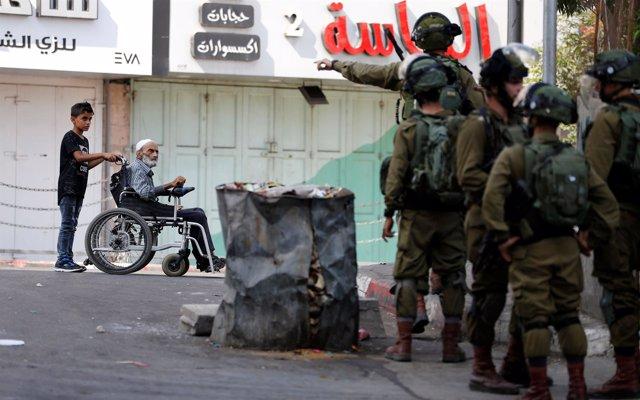 Palestinos y Ejército israelí en Nablús (Cisjordania)