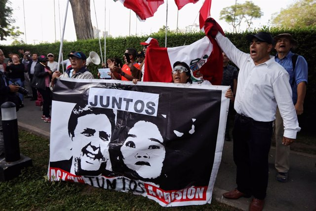 Protesters against former President Alan Garcia gather outside the residence of