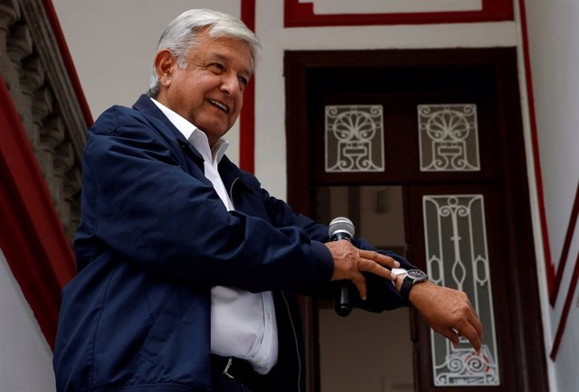 FILE PHOTO: Mexico's president-elect Andres Manuel Lopez Obrador shows his watch