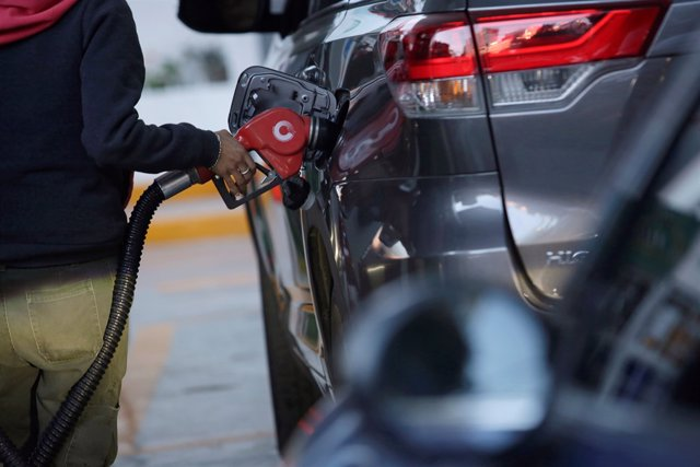An employee fills the tank of an SUV at a gas station in Mexico City, Mexico, Ja
