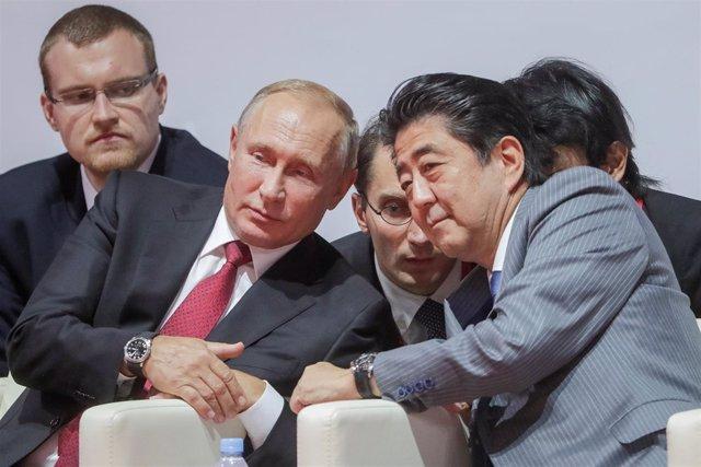 Vladimir Putin y Shinzo Abe