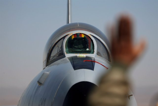 A military plane is seen after its last flight during a ceremony of cessation of