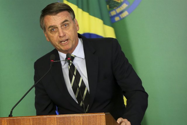 Bolsonaro signs decree easing gun restrictions in Brazil