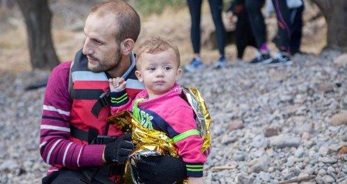 Padre e hijo refugiados