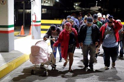 Más de 1.000 migrantes de la segunda caravana hondureña regresan a su país