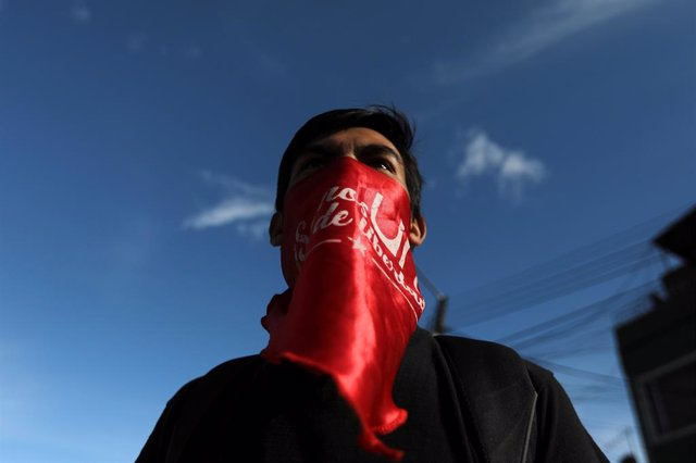 A student participates in a march to demand from the national government, more r