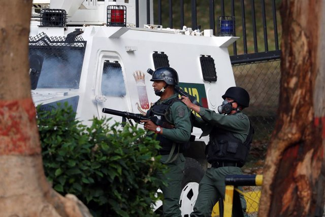 Venezuelan National Guards fire tear gas during clashes with demonstrators durin