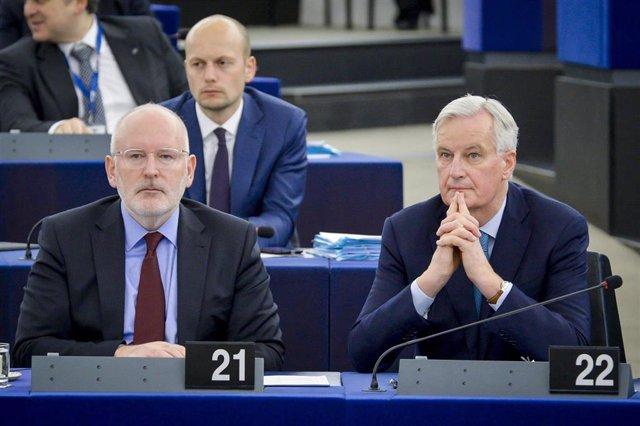 Michel Barnier y Frans Timmermans
