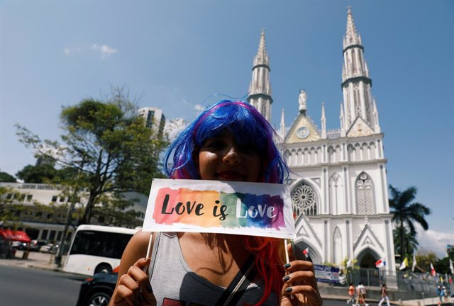 A member of the LGBT community holds a sign during a Kissathon to demand equal r